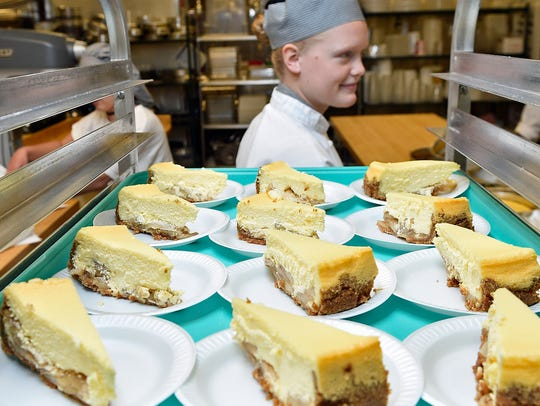 Abigail Ziebarth, 18, prepares cheesecake with other