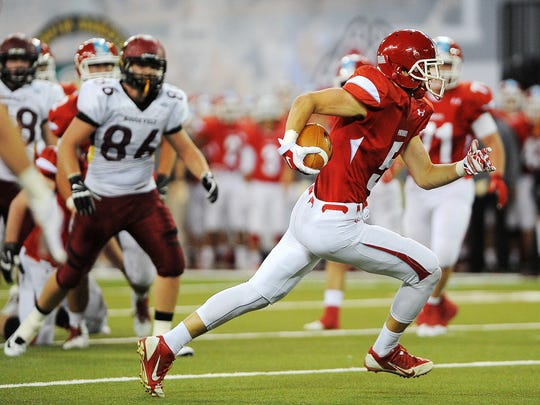 Lincoln's Nickel Meyers, shown here in the 2014 state football finals against Roosevelt, has made a big impact since transferring to Augustana from USD.