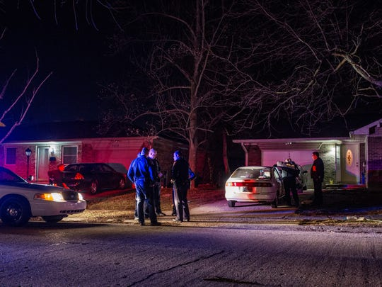 IMPD officers and investigators gather outside a home in the 4000 block of Malibu Drive on the city's northeast side where a man was found fatally shot late Monday, Feb. 29, 2016.