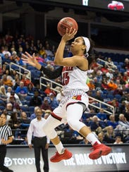 FILE - In this March 2, 2018, file photo, Louisville's Asia Durr (25) jumps for a shot during the first half of an Atlantic Coast Conference tournament basketball game against Virginia Tech in Greensboro, N.C. Durr was named to the Associated Press women's NCAA college basketball All-America first team team, Monday, March 26, 2018. (AP Photo/Ben McKeown, File)