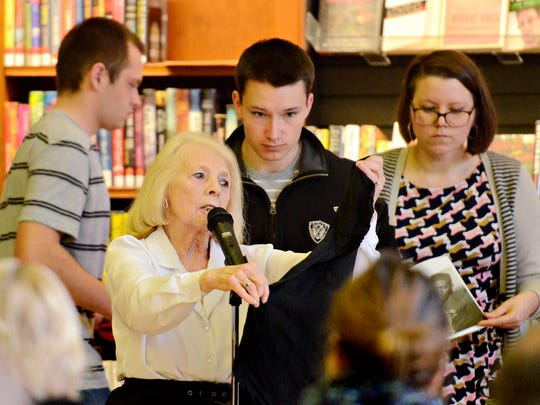 Martin Library Marketing Director Fran Keller holds up a David Copperfield t-shirt as her runners Max Clarke, Aidan Mikula, and Danielle Davis, work behind her during the 19th Annual Celebrity Auction held at Martin Library in York City, Sunday, March 20, 2016. Dawn J. Sagert photo