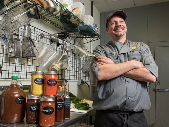 Chef Chris Kelly poses with some of the homemade sauces