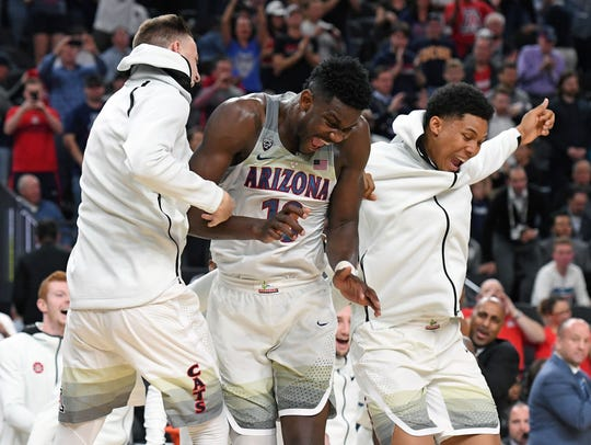 Freshman superstar Deandre Ayton (middle) is a double-double