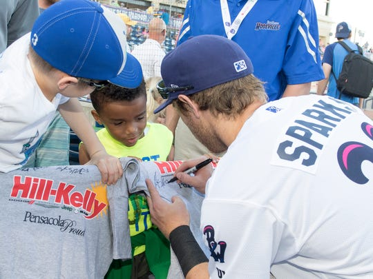 Taylor Sparks (23) signs autographs prior to the opening day game between the Chattanooga Lookouts and the Pensacola Blue Wahoos in Pensacola on Wednesday, April 11, 2018.