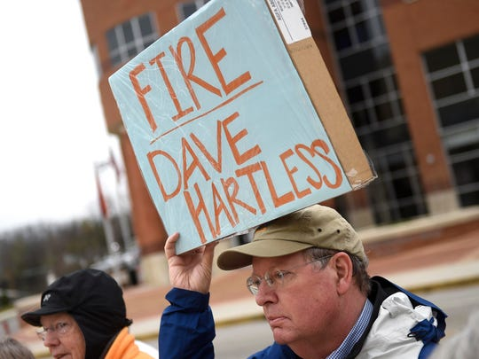 A protester carries a sign showing his displeasure with UT athletic director Dave Hart during a rally to bring the Lady Vols brand and logo back to UT women's athletics Dec. 20, 2014, at Pat Summit Plaza.
