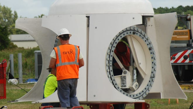 Workers prepare the turbine hub to attach the 3 propellers at the Crisfield wind project Friday, Sept. 16.