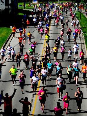 Runners and walkers on Libal Street during the 2014 Bellin Run, Saturday, June 14, 2014.