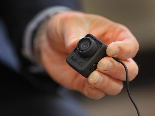 IMPD Lt. Mark Wood shows a Digital Ally body cam.