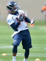 Denver Broncos' Cody Latimer catches a pass one handed during NFL football rookie camp, Friday, May 16, 2014, in Englewood, Colo.