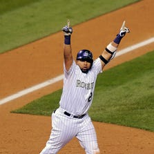 Colorado Rockies' Wilin Rosario celebrates his game-winning two-run home run in the ninth inning of a baseball game against the Arizona Diamondbacks Thursday, Sept. 18, 2014, in Denver. The Rockies won 7-6.