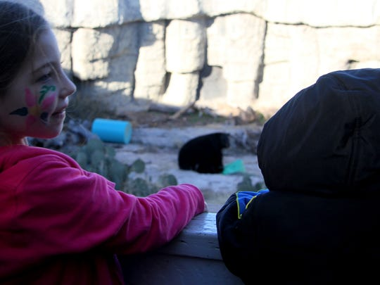 Maggie opens her present while her smallest fans watch Saturday at the Living Desert Zoo.