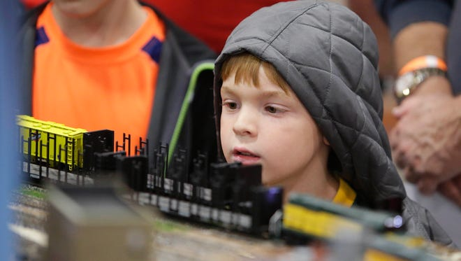 Wade Pheffer operates a train as part of the Junior Engineer program at  Trainfest, considered America's largest  operating model operating railroad show, at  Wisconsin State Fair Park in 2015.