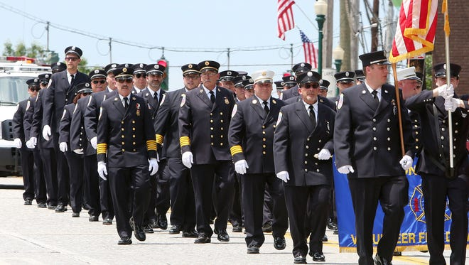 Croton firefighters proudly march along the streets of Croton during the Croton Fire Department's 125th anniversary parade on June 10, 2017.