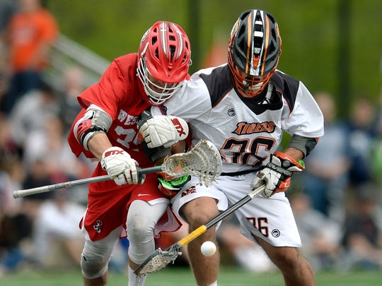 RIT's Nate Farrell, right, and Wesleyan's Zach Zavalick