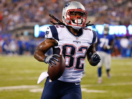 New England Patriots wide receiver Keshawn Martin runs for a touchdown during the first half of a preseason NFL football game against the New York Giants on Thursday, Sept. 1, 2016, in East Rutherford, N.J. (AP Photo/Kathy Willens)