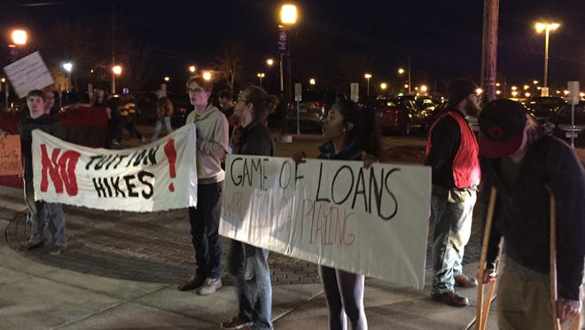 Students and others protest Saturday night at the Herb Brooks National Hockey Center.