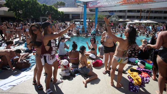 Lesbians attend the Cabana Pool Party at the Palm Springs Hilton on Saturday, April 2, 2016 as part of the Dinah Shore Weekend.