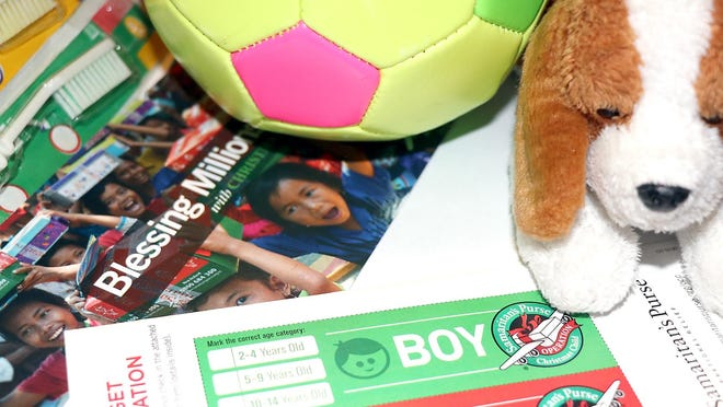The 2020 Operation Christmas Child gift tags and sample items for packing.