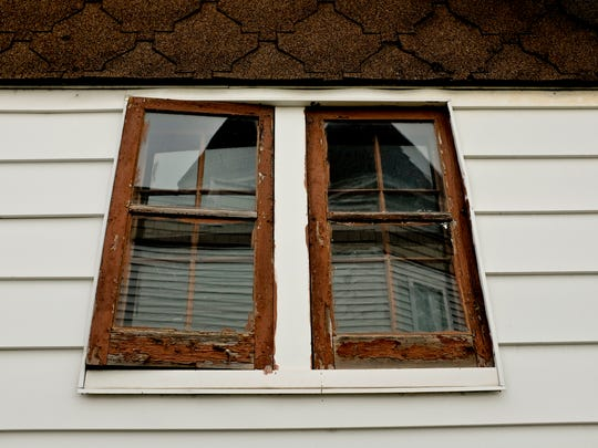 An exterior window is seen at 3821 Military Street in Port Huron.
