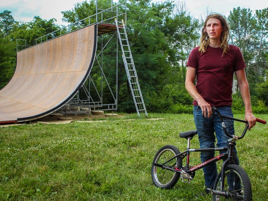 Zach Newman takes a rest after practicing tricks for his upcoming showing at the X-games Monday, July 3, 2017 in Hamilton, Ohio.