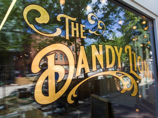 The front window of Dandy Lion is seen on Tuesday, July 3, 2018. Dandy Lion is now open and will be expanding their hours after pedestrian mall construction is completed.