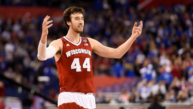 Apr 4, 2015: Wisconsin Badgers forward Frank Kaminsky (44) reacts against the Kentucky Wildcats in the second half of the 2015 NCAA Men's Division I Championship semi-final game at Lucas Oil Stadium.