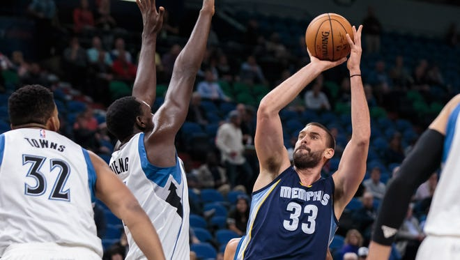 Memphis Grizzlies center Marc Gasol (33) shoots in the first quarter against the Minnesota Timberwolves center Gorgui Dieng (5) at the Target Center in Minneapolis on Wednesday.