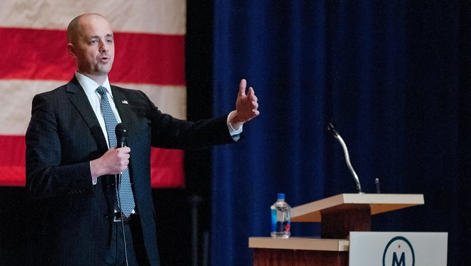 In this Wednesday, Oct. 12, 2016 photo, Evan McMullin, a conservative independent presidential candidate, speaks at a town hall meeting in Logan, Utah. (Eli Lucero/The Herald Journal via AP)