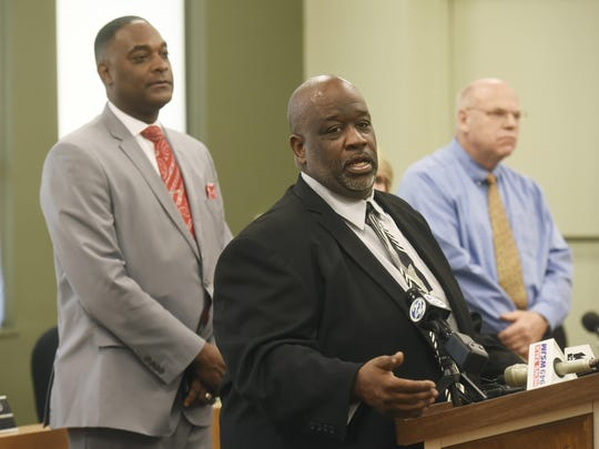 From left, Benton Harbor Mayor Marcus Muhammad, Benton Harbor City Manager Darwin Watson and Berrien County Medical Director Dr. Rick Johansen hold a press conference Wednesday, Oct. 24, 2018, at City Hall in Benton Harbor, Mich., to let the public know that the city's water system is under a state advisory for lead after summer sampling revealed higher-than-acceptable levels.