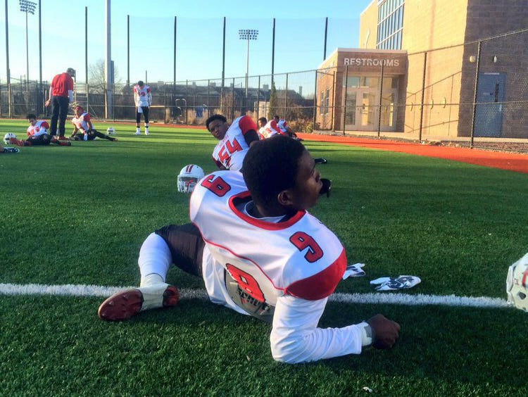 Palmyra senior wide receiver and University of South Carolina recruit Kelvin Harmon leads the Panthers' football team in stretches before their Central Jersey Group 1 final on Dec. 5 at Kean University.