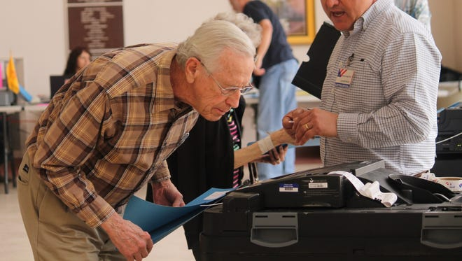 This resident watches his ballot being casted on Tuesday afternoon.