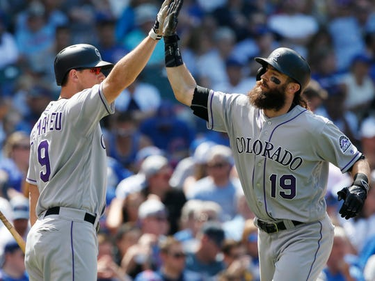 Colorado Rockies' Charlie Blackmon, right, celebrates with DJ LeMahieu after hitting a two-run home run against the Chicago Cubs during the fifth inning of a baseball game Friday, June 9, 2017, in Chicago. (AP Photo/Nam Y. Huh)