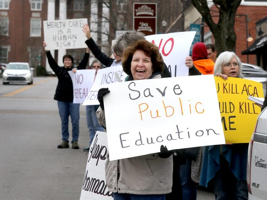 Rena Scudder, a retired school teacher protested infront