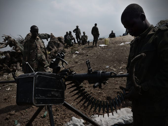 A young M23 rebel loads a machine gun. The deadliest war in modern African history is happening here in the Democratic Republic of the Congo. For two decades, at least 20 armed groups have been fighting in this stunning landscape of jungles, volcanoes and rolling farms.