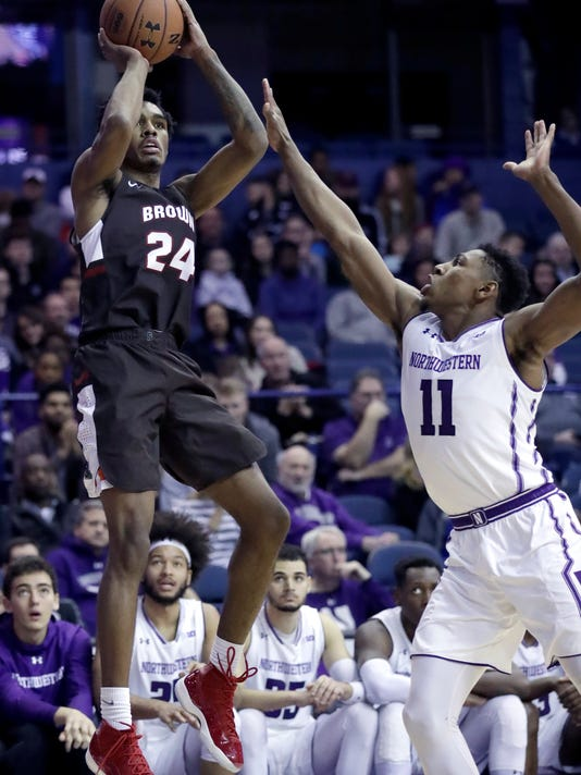Brown guard Desmond Cambridge, left, shoots against Northwestern guard Anthony Gaines during the first half of an NCAA college basketball game, Saturday, Dec. 30, 2017, in Rosemont, Ill. (AP Photo/Nam Y. Huh)