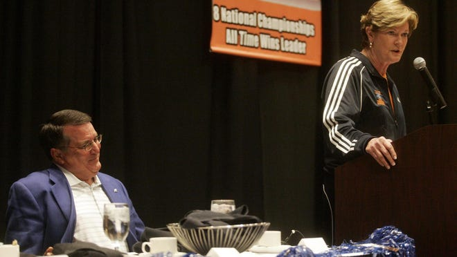 MTSU women's basketball coach Rick Insell listens to UT women's basketball coach Pat Summitt speak at the Breakfast of Champions in 2009. Both coaches share a friendship that spans decades.