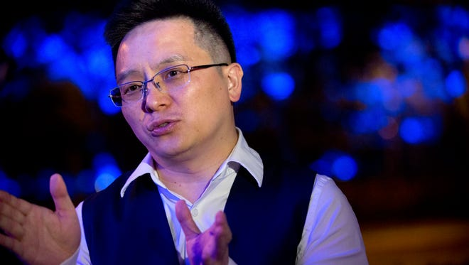 In this Friday, May 20, 2016, file photo, Recon Group CEO Tony Xia Jiantong speaks during an interview about buying the British soccer club Aston Villa, in Beijing.