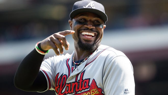 Atlanta Braves second baseman Brandon Phillips (4) reacts in the direction of his mother after hitting a single and his 2,000th career hit against Philadelphia Phillies starting pitcher Jerad Eickhoff (not pictured) during the first inning at Citizens Bank Park.