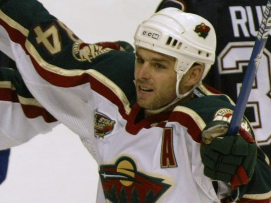 MINNESOTA WILD PASCAL DUPUIS CELEBRATES GOAL AGAINST VANCOUVER CANUCKS DURING NHL PLAY