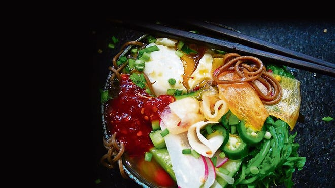 Naengmyeon is exceptional served cold. Don't heat it up!