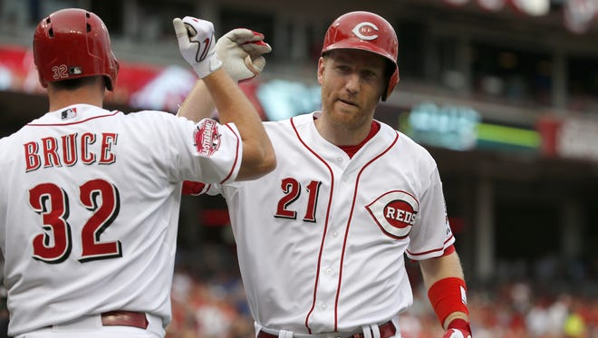 Cincinnati Reds third baseman Todd Frazier (21), right, is congratulated by Cincinnati Reds right fielder Jay Bruce (32), left, after hitting a solo home run in the bottom of the first inning.