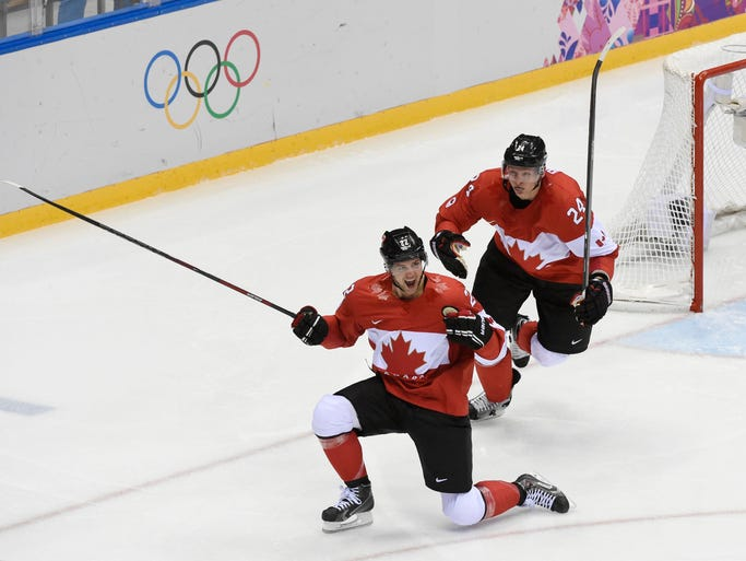 Canada forward Jamie Benn (22) celebrates with forward Corey Perry (24) after scoring a goal against USA.