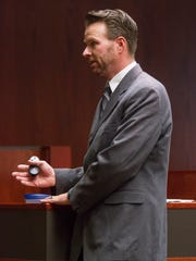 Deputy county attorney Mike Edwards provides his closing
