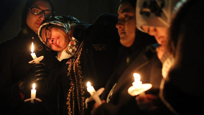 Nida Allam, a senior at North Carolina State University, rests her head on Asheen Allam, during a vigil for three people who were killed at a condominium near UNC-Chapel Hill, Wednesday, Feb. 11, 2015, in Chapel Hill, N.C. Craig Stephen Hicks appeared in court Wednesday on charges of first-degree murder in the deaths Tuesday of Deah Shaddy Barakat, his wife Yusor Mohammad and her sister Razan Mohammad Abu-Salha. (AP Photo/The News & Observer, Al Drago)