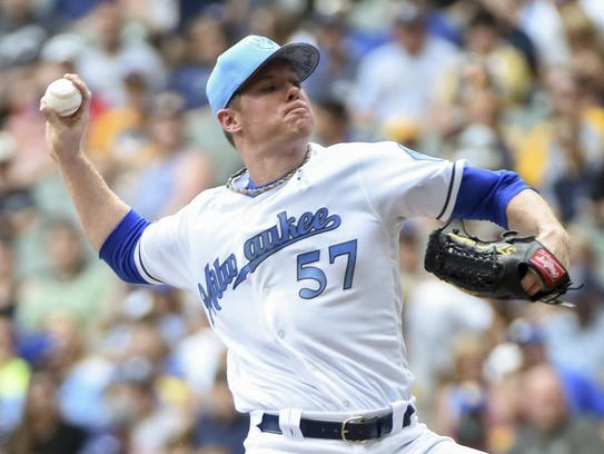 Milwaukee Brewers pitcher Chase Anderson (57) pitches