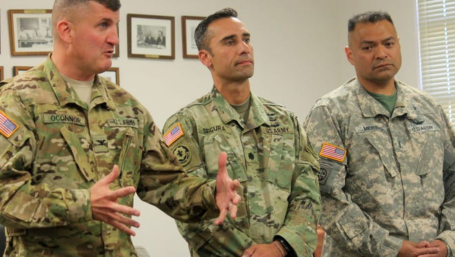 From left to right: Col. Tom O'Connor, Commander of the Combat Aviation Brigade, Lt. Col. Segura, G3 for Air Operations and Chief Pilot Murino, Combat Aviation Brigade presented to county commissioners their proposal to train in Lincoln National Forest to practice high altitude flying and landing.
