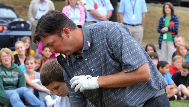 A 6th grade student gets a quick lesson from PGA Professional Bo Van Pelt at Glen Miller Golf Course in September 2010.