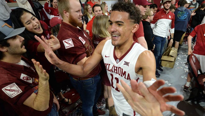 Oklahoma Sooners guard Trae Young (11) is greeted by fans after defeating the Kansas State Wildcats at Lloyd Noble Center.