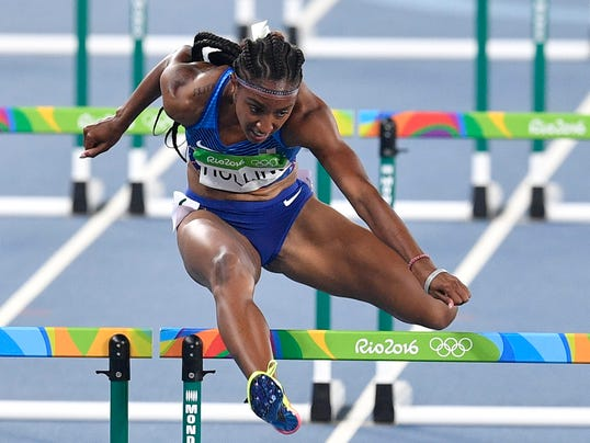 FILE - In this Aug. 17, 2016, file photo, United States' Brianna Rollins competes in the women's 100-meter hurdles final during the athletics competitions of the 2016 Summer Olympics at the Olympic stadium in Rio de Janeiro, Brazil. Rollins has received a one-year suspension for failures to disclose her whereabouts to anti-doping officials. Her suspension is retroactive to Sept. 27, 2016, the date of her last missed whereabouts report. Her gold medal, part of a sweep by U.S. 100-meter hurdlers at the Rio Games last year, will not be stripped. (AP Photo/Martin Meissner, File)