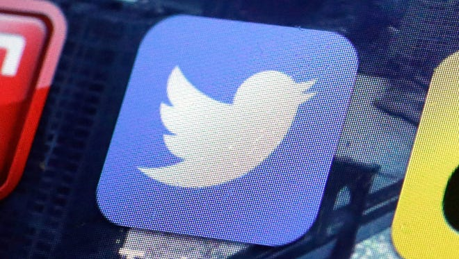 A Twitter app on an iPhone screen is shown.